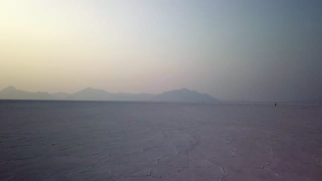 Summer Evening on the Salt Flats Slow moving drone shot of the salt flats in Utah. salt flat stock videos & royalty-free footage