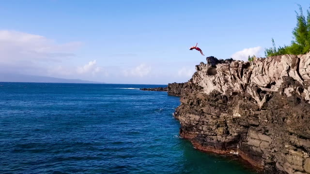 Summer Extreme Sports Cliff Jumping Outdoor Lifestyle Extreme Cliff Jumping Backflip. Summer Extreme Sports Shot from Above Aerial View. cliff jumping stock videos & royalty-free footage