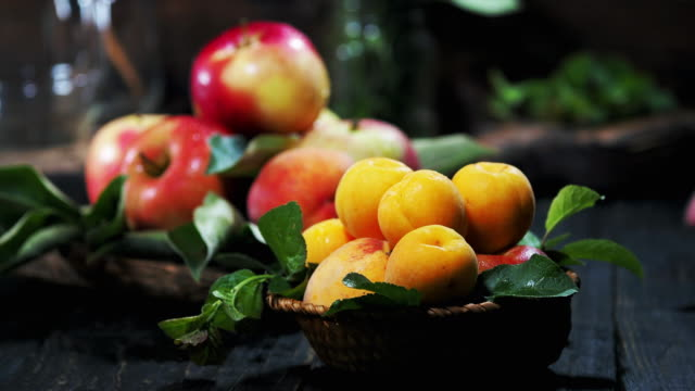 summer fruit on the wooden table - albicocca video stock e b–roll