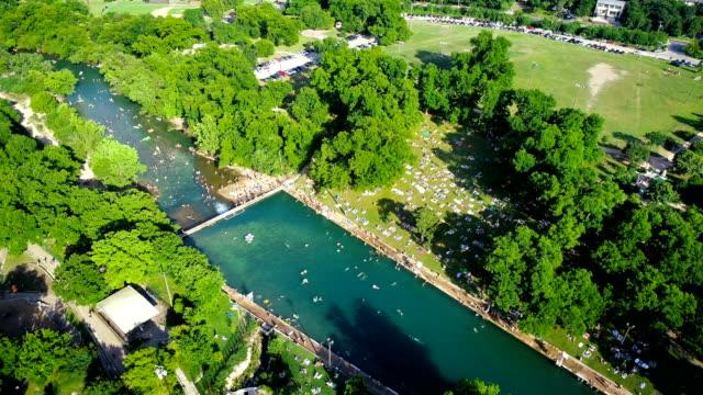 Summer Heat brings Huge Crowds Swimming at Barton Springs Pool in Austin , Texas