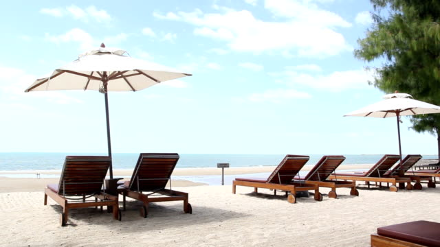 Summer holiday on beach with white sand and sunbeds in Thailand, Hua Hin Beach video