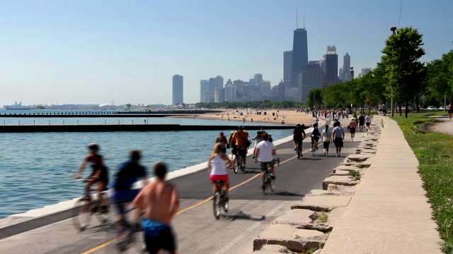 Summer in the City Time Lapse Cyclists and runners enjoying a summer day on the Lakefront path along the Lake Michigan shoreline in Chicago.  chicago stock videos & royalty-free footage