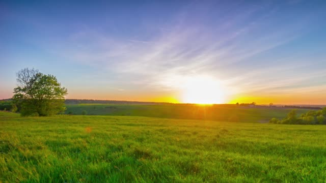 Summer landscape with a sunset, 4K panoramic time-lapse video