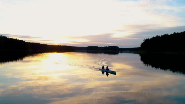 summer relaxing activity. kayaking during sunset - lakes stock videos and b-roll footage