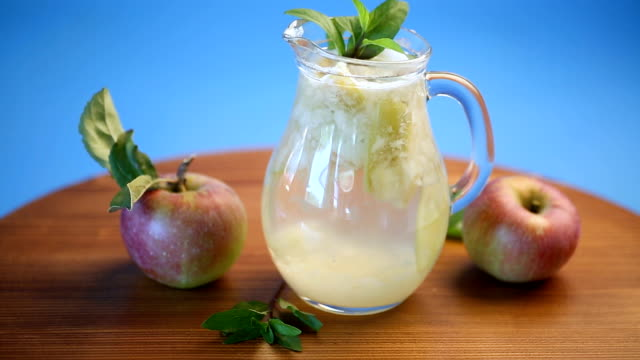 summer sweet cold compote of fresh apples with a sprig of mint - decanter video stock e b–roll