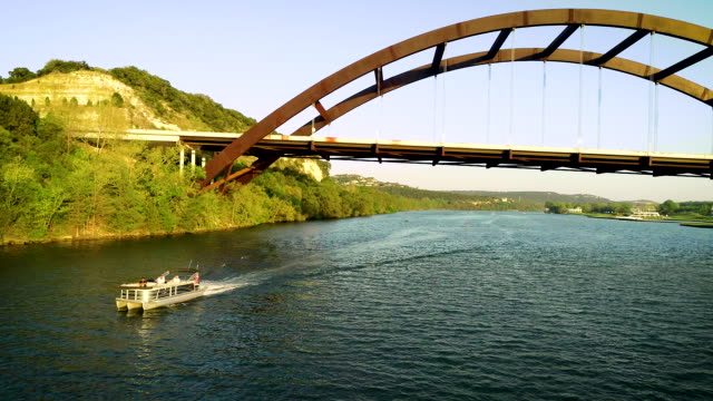 Summer time on the Town Lake under Pennybacker Bridge - Austin , Texas