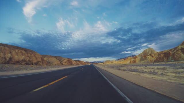 Summer vacations in California: POV car driving the roads of Death Valley National Park