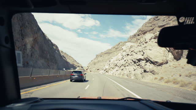 Summer vacations in USA: POV driving highways of wild Southwest