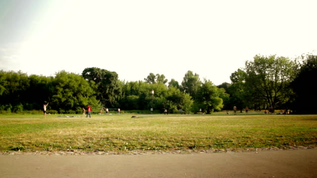 Summertime city park badminton timelapse video