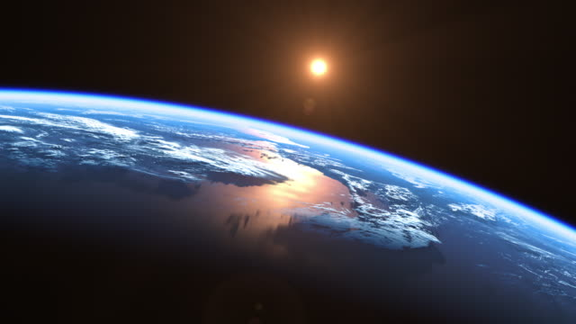 Sun Above Blue Planet Earth. View From Space. 4K.