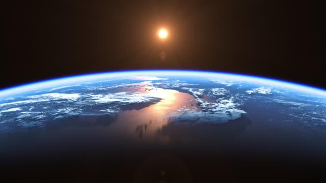 solen över planeten jorden. vy från rymden. 4k. sömlös loopas. - map oceans bildbanksvideor och videomaterial från bakom kulisserna
