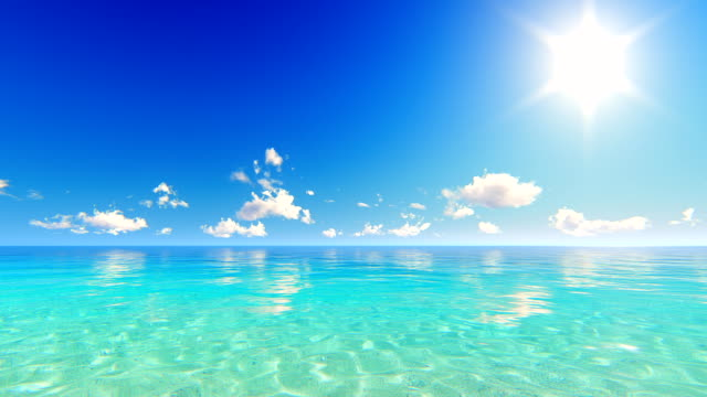 Sun and moving clouds over tropical ocean video