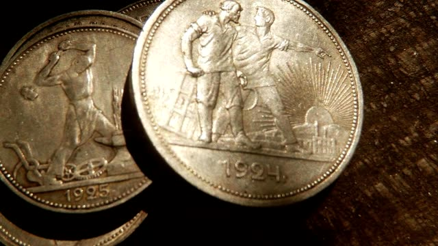 Sun and Shadow Play on Old Soviet Silver Coins with Farmworkers and Workers on Obverse Super Close Up video