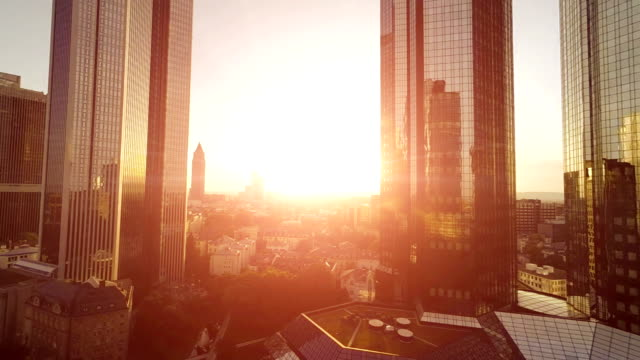 sun beams trough skyline buildings video