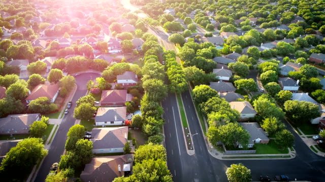 Sun burst Sun beams Modern Spring time suburb homes Neighborhood Community Green landscaping and modern Suburb suburbia aerial drone view looking down from above Sun burst Sun beams Modern Spring time suburb homes residential district stock videos & royalty-free footage