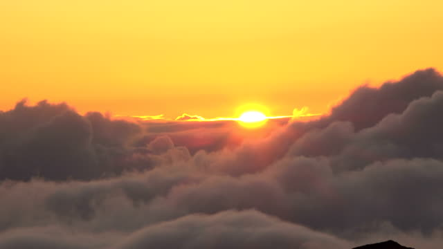 Sun Disappearing Behind Soft Clouds Above Maui Volcano Maui Island, Sunset - Mountain, Volcano low lighting stock videos & royalty-free footage