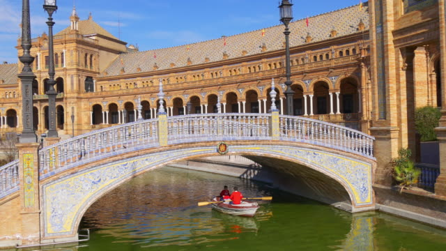 sun light plaza de espana kids boat riding 4k seville spain video