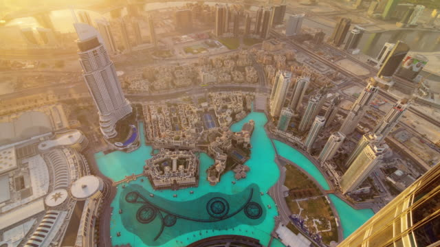 sun light world highest building mall fountain roof top view 4k time lapse united arab emirates video