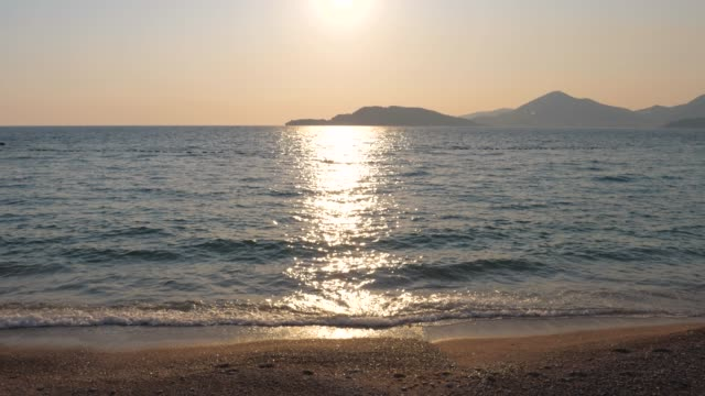 sun makes shiny road on the water, view sparkling and shimmering sea. 4k - mediterranean sea stock videos & royalty-free footage