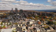 istock Sun moving across the urban landscape in New Rochelle New York 1184684366