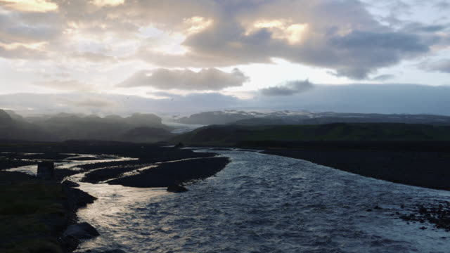 Sun over Icelandic wetland. River pool video
