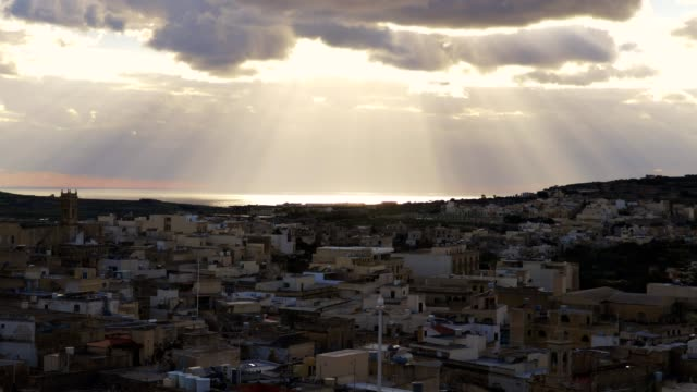 sun rays coming out from the clouds and light up the city-Valletta, Malta video