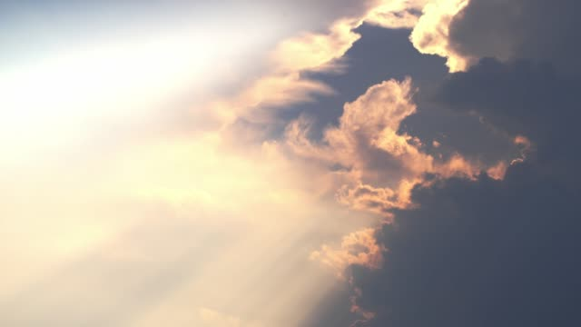 sun rays emerging clouds ,timelapse - paradiso video stock e b–roll