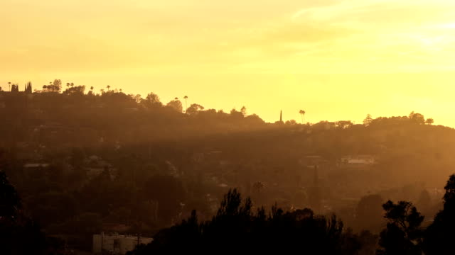 Sun rays moving over Hollywood Hills at sunset video
