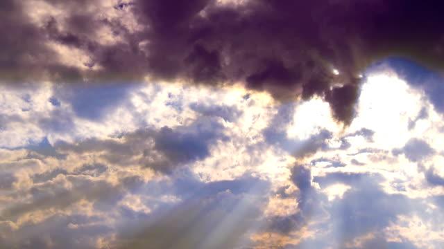 Sun rays open the cloud door in sky video