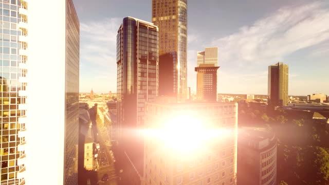 sun reflecting in glass facade of skyscraper building