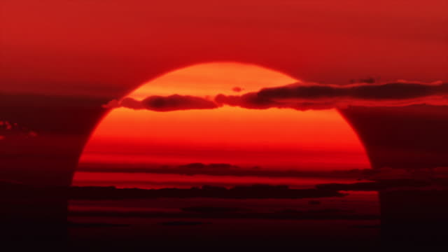 huge sun rises - sunset stock videos & royalty-free footage