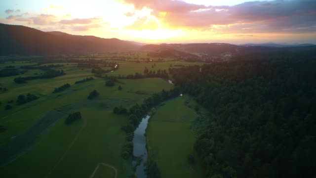 AERIAL Sun rising above a countryside