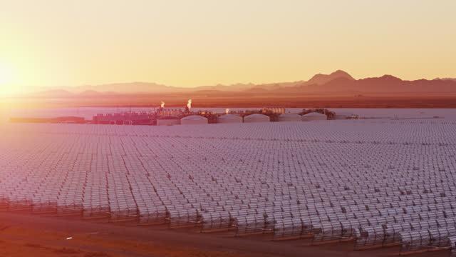 Sun Rising Over Parabolic Trough Solar Plant - Aerial