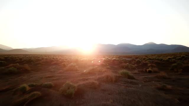Sun Rising Over Ridge of Mountains in California