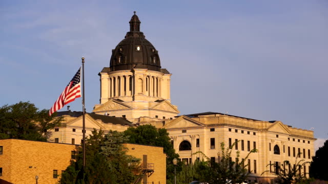 sun rising south dakota state capital building hughes county pierre sd - kapitell stock-videos und b-roll-filmmaterial