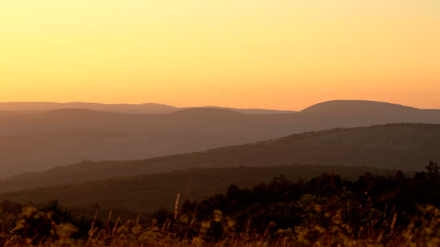 Sun setting behind the mountain