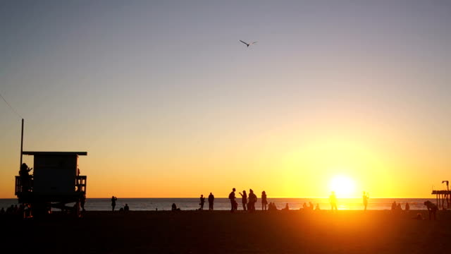 Sun Setting Beside Lifeguard Stand on Santa Monica Beach video