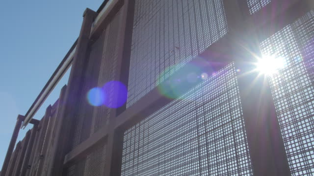Sun Shines Through Fence on US and Mexico Border video