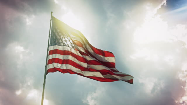 sun shining on us flag - democrazia video stock e b–roll