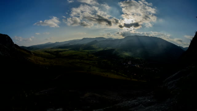 Sunbeams above Remetea village Transylvania crags and fields video