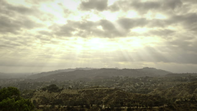 Sunbeams through clouds time lapse video