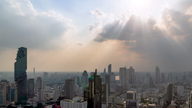Sunburst or sun rays or god light beam through the cloud over Bangkok business district city center above Silom area – Time Lapse Sunburst or sun rays or god light beam through the cloud over Bangkok business district city center above Silom area – Time Lapse dramatic sky stock videos & royalty-free footage