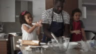 istock Sunday Morning Mix Race Family Cooking Cookies 1195261790