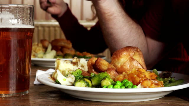 Sunday roast: people eating in a pub two people eating at the pub roasted stock videos & royalty-free footage