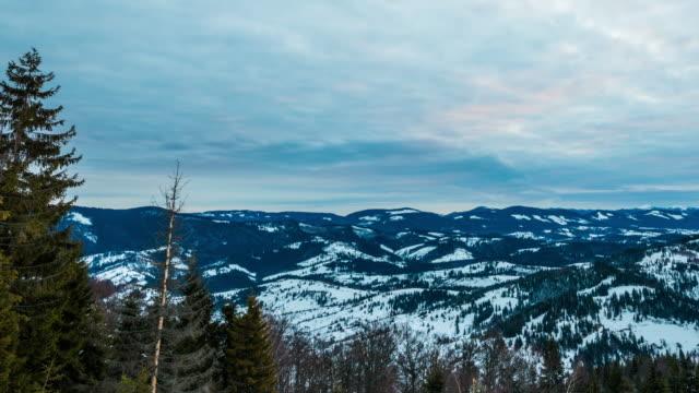 sonnenuntergang winter berg, timelapse - panorama stock-videos und b-roll-filmmaterial