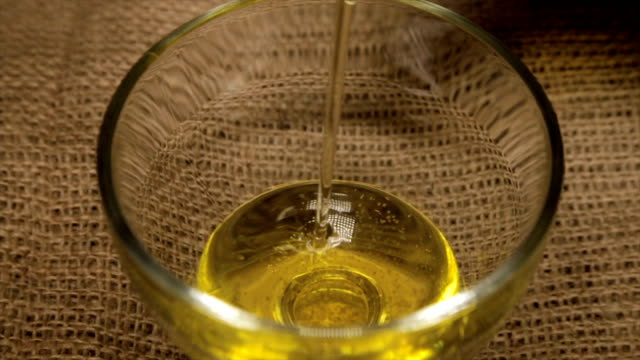 Sunflower seed oil in a glass bowl close-up. video