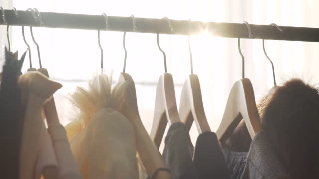 Sunlight between hangers for clothes. Solar Design Studio video