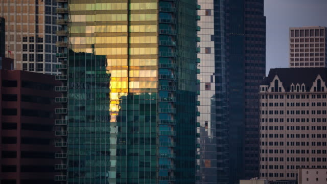 Sunlight Fading from Tall Downtown Buildings - Time Lapse video