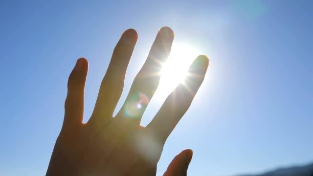 Sunlight passing through fingers video