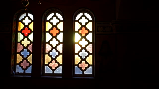 sunlight through church stain-glass window - church architecture stock videos & royalty-free footage
